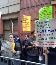 Protestors from the Ad Hoc Committe against the Militarization outside of David Petraeus's class on Sept. 23.