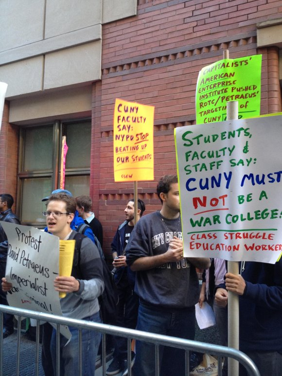 The heavily policed and protected scene, a response to protests against Gen. David Petraeus teaching a class at CUNY, is ...