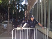 Officer Leonardo preventing pedestrians from entering the 67th Street block where the Ad Hoc Committee against the Militarization of CUNY was holding a protest.