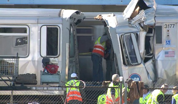 A Chicago commuter train that was parked in a service yard somehow moved onto a rail line and smashed into ...