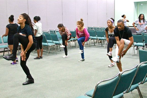 Expo attendees participate in the Step 4 Health Fitness Clinic.
