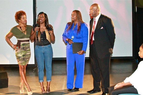Coach Mai Brooks, far left, and West Coast Expo organizers, far right, Natalie Cole and David Miller, congratulate participants in the Weight-A-Minute weight loss competition.