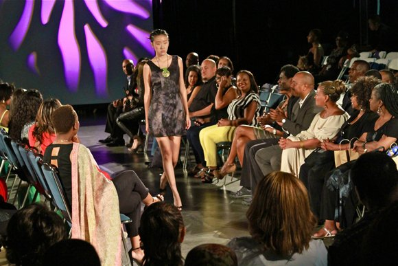 Model struts down the runway at the Lights, Camera, Runway! fashion show.