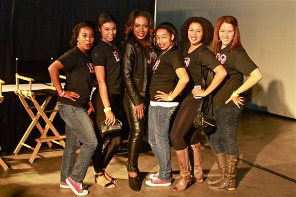 West Coast Expo celebrity host Sheryl Lee Ralph, center, stops a moment to visit Delta Sigma Theta sorority steppers.