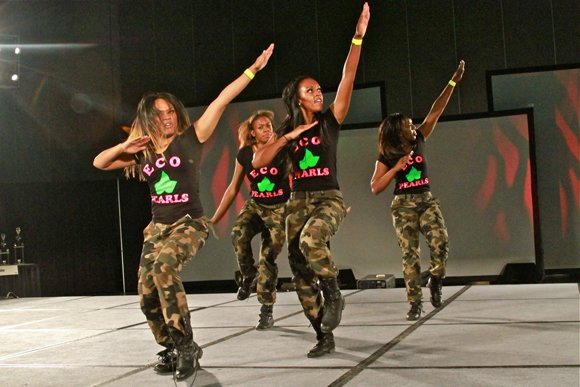 Ladies of the Alpha Kappa Sorority Eco-Pearls step with a message.