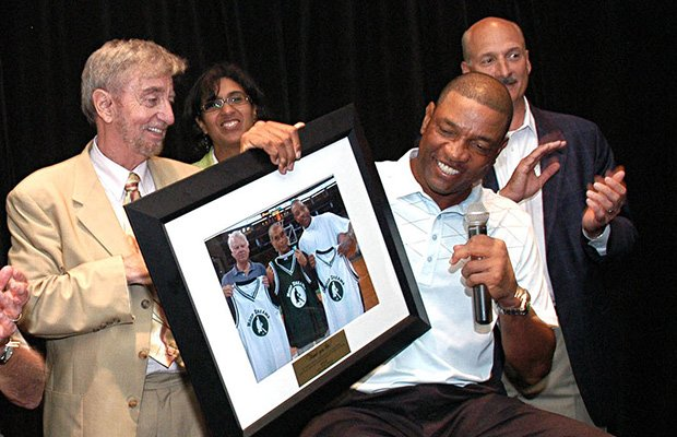 Action for Boston Community Development president and CEO John J. Drew (left)giving former Boston Celtics coach Doc Rivers (right) a framed photo plaque as thanks for his support of ABCD at the organization's Hoop Dreams fundraiser at TD Garden.