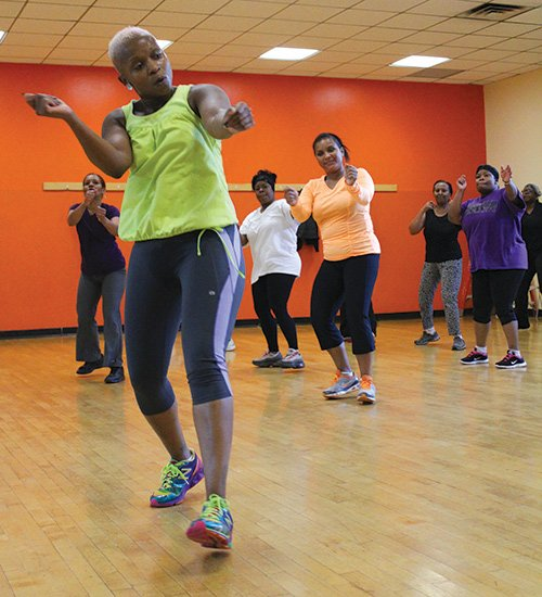 Eyoda Williams, a certified trainer, leads her Socalicious class at the Dorchester YMCA.