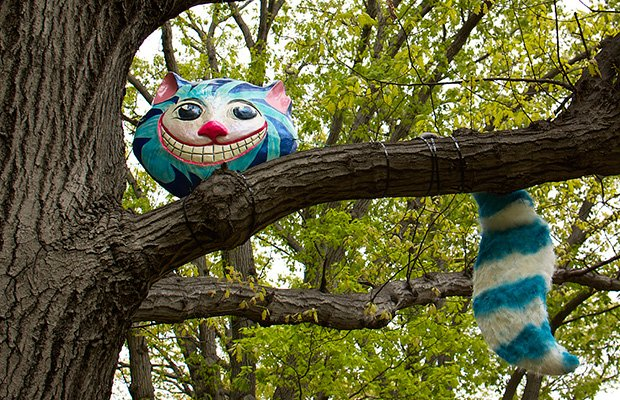 """""""Sculpture in the Park"""" is an outdoor public art exhibit at Franklin Square Park sponsored by United South End Settlements. The exhibit kicks off with a reception from 1pm-3pm. on Oct. 19. Eight local artists and a group of students from USES' Children's Art Centre will install sculptures from trees, from fences and along the lawn. The exhibit runs through Nov. 3. """"Cheshire Grin"""" by Lyn MacDonald pictured above."""