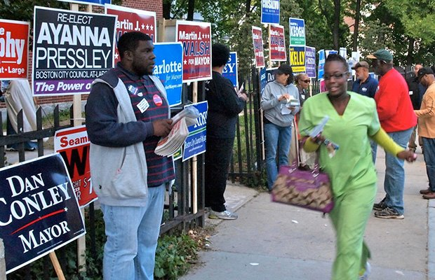Political activist Kevin Wilkerson canvassing for votes outside of the Lewis School on Walnut Ave. in Roxbury.