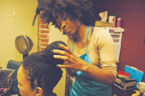 """As a child, Amber Starks used to """"beg"""" her mother to let her perm her long locks of hair. It ..."""