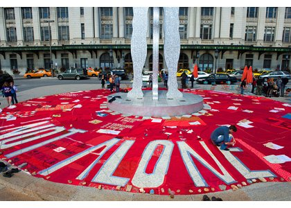 In the bright afternoon sun on Sunday, September 29, 2013, one hundred bright red quilts were displayed in the center ...