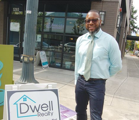 Dwell Reality Broker Chris Guinn III serves customers from a storefront in the Vanport Plaza in northeast Portland.