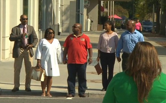 The family of Miriam Carey, the driver killed in the Capitol Hill shooting, is seen leaving the D.C. Medical Examiner's Office in the company of an attorney.