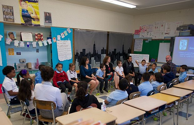 Third-graders at the Tobin School participate in an Open Circle lesson. Students were joined by Pamela Audeh from the Center for Community Health and Health Equity at Brigham and Women's Hospital, Catherine Fine from the Division of Violence Prevention at the Boston Public Health Commission,Tobin Principal Efrain Toledano, third-grade teacher Brian Fizer and Maggie Corcoran from Partners Community Health at Partners HealthCare.