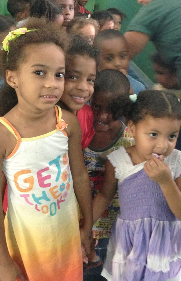 "Children from the ""City of God"" favela line up for lunch at a day care and education center supported by the Developing Minds Foundation. (Photos courtesy of Erint Images)"