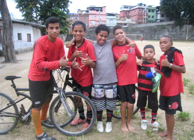 Members of a youth soccer team in the Mangueira favela in Rio de Janeiro greet a visitor to their practice field. (Left to right) Marcelo da Silva Salles, Lucas Lopes Custodio, Isaac Lopes, Wellington Carolos, Bruno Nascimento and George Pereira.