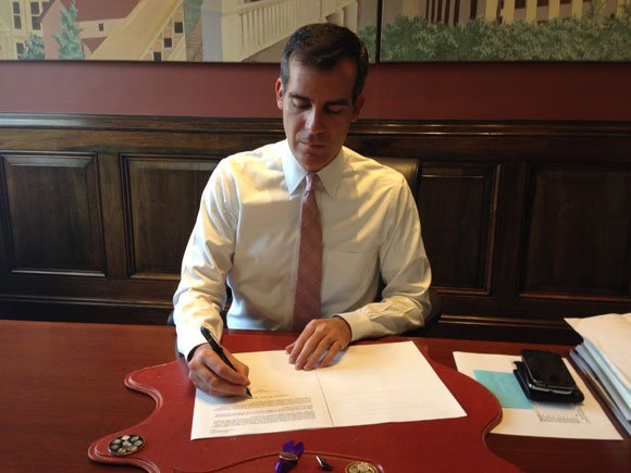 Mayor Eric Garcetti signing his first Executive Directive that will establish the City of Los Angeles' 'Great Streets' program to create jobs and make city government work better.
