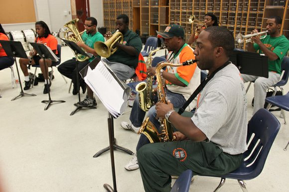 When Florida A&M University's Marching 100 Alumni Band members get together, it's like a great big family reunion.
