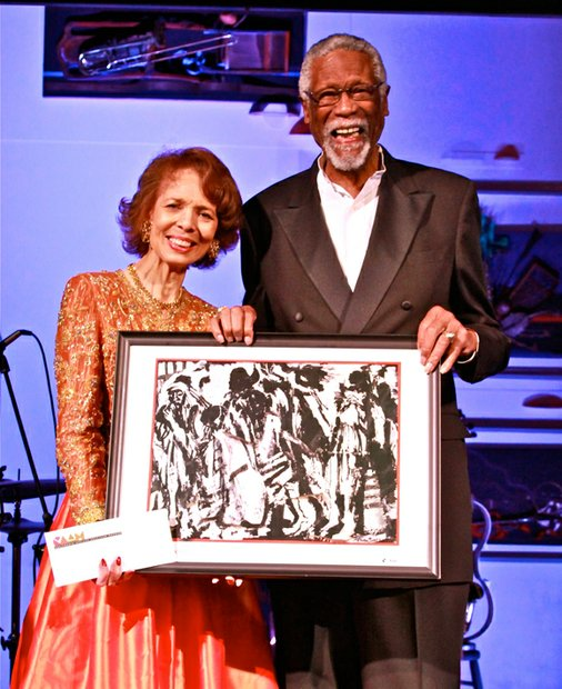 "NBA Hall of Fame player, coach and announcer, Bill Russell (right), presents a Lifetime Achievement Award to collage artist and ""artpreneur,"" Phoebe Beasley at CAAM's annual gala."