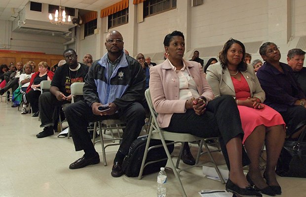Anti-violence activists gather in the Bromley Heath Community Center to share ideas about stemming the tide of gun violence in Massachusetts. In the front row are (left-right) Ruth Rollins, Kim Odom and Clementina Chery. (Yawu Miller photo)