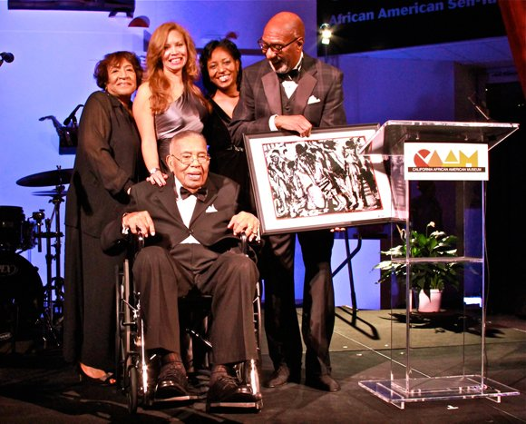 L.A. business owner and philanthropist Leon T. Garr (seated), is surrounded by family and friends after receiving CAAM's Lifetime Achievement Award.