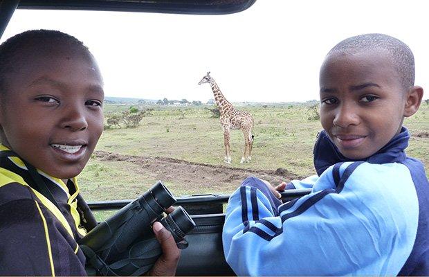 The four students being sponsored by Project MEMA went on a safari at Arusha National Park. Thomson Safari sponsored the trip. (Photo courtesy of Project MEMA)