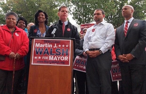 State Rep. Martin Walsh is endorsed by former mayoral candidate Charlotte Golar Richie during a press conference in front of the First Parish Church in Dorchester. (Left-right) Laura Younger, State Rep. Gloria Fox, Richie, Walsh, City Councilor Felix G. Arroyo, and former mayoral candidate John Barros. (Yawu Miller photo)