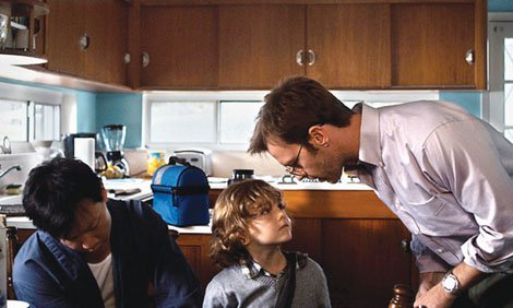 Joey (portrayed by Patrick Wang, left) and Cody (Trevor St. John) with their son Chip (Sebastian Brodziak) in a scene from the film 'In the Family.'