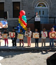 "St. Vincent de Paul of Baltimore opened a new Head Start Center on Caroline Street in the Oliver Neighborhood in Baltimore on Tuesday, October 15, 2013. (Above) Children from the new St. Vincent de Paul Head Start Center hold up letters that spell out ""We Love Our School"" as Baltimore City Council President Jack Young (right) looks on."