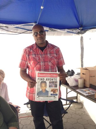Daniel Aquendo, Sr., father of Avonte Oquendo, holds the front page of the Amsterdam News featuring his missing son.
