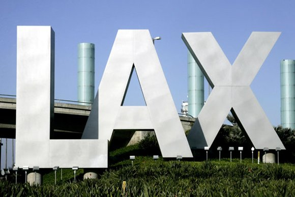 A suspect armed with an assault rifle shot his way through a security gate in Terminal 3 at Los Angeles ...