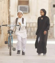 Waad Mohammed (right) plays a Saudi girl who wants a bicycle to race her young male friend in the film 'Wadjda,' a story that gives us a rare window into everyday life for women and girls in Saudi Arabia.