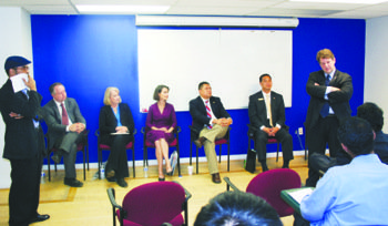 Democratic candidates for Virginia's House of Delegates talk to ethnic media reporters at a candidates' forum. From left (standing): Khalil Abdullah, New America Media, and candidates John Bell, Kathleen Murphy, Jennifer Boysko, Richard Cabellos, Hung Nguyen and Alfonso Lopez.