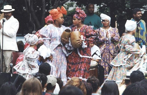 Inquilinos Boricuas en Accion's first began putting on public Latino arts and culture performances in the 1980s, such as the bomba performance shown above.