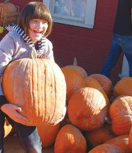 Veda Roser, 9, enjoys a visit to the Pumpkin Patch on Sauvie Island where families get into the harvest season with several fall attractions, including hay rides, a fresh produce market, and a popular cornfield maze.