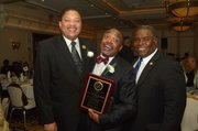 Geoffrey Eaton, Roy Wilkins Community Service Award honoree William F. Perry and presenter Robert Reed