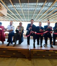 D.C. Delegate Eleanor Holmes Norton and Mayor Vincent Gray joined city leaders in cutting the ceremonial ribbon for the opening of the St. Elizabeths East's Gateway Pavilion on Wednesday, Oct. 23.