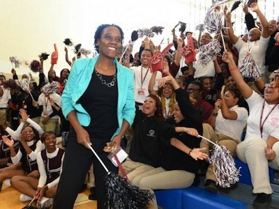 Students at Thurgood Marshall Academy in D.C. cheer as physics teacher Kena Allison is surprised Thursday with the Milken Educator Award during an assembly. (Courtesy of Milken Family Foundation)