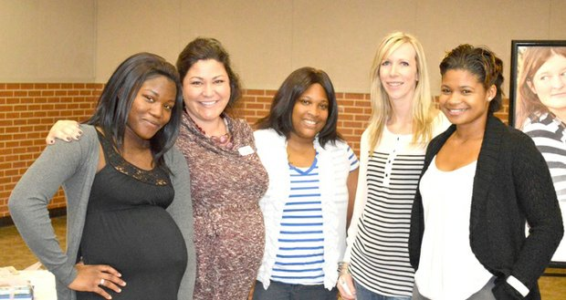 Volunteer coordinator Nicole Hernandez (second from left) and Executive Director Emily Dock (second from right) joined current and former Bridges Safehouse residents at the Annual Community Breakfast.