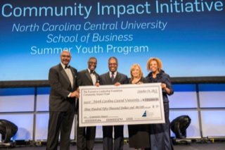 Ronald C. Parker, president and CEO of the Executive Leadership Council and Foundation (left), presents Dr. Debra Saunders-White (second from right), chancellor of North Carolina Central University, a $350,000 grant for a youth education program. Also participating was Lynton Scotland, Michael C. Hyter, chairman of The Executive Leadership Foundation (ELF) board and managing director, Korn/Ferry International, and Tracey Gray-Walker (right). The grant was provided under ELF's Community Impact Initiative, a national program aimed at closing the achievement gap among black middle and high school students. (PRNewsFoto/Executive Leadership Council)