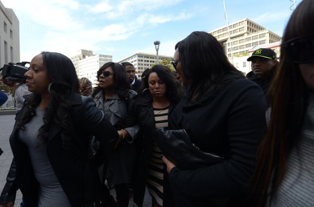 Joyce Hawkins (center), mother of singer Chris Brown, is surrounded by family and security on Oct. 28 as she enters D.C. Superior Court in support of her son after a weekend arrest for assault charges in the District.