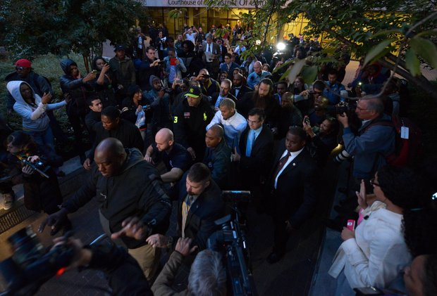 Singer Chris Brown (center), surrounded by U.S. Marshals and security personnel, makes his way through fans and members of the press on Oct. 28 after he was released from D.C. Superior Court following a weekend arrest for assault charges.