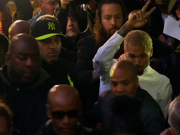 The charges against singer Chris Brown and his bodyguard stemming from a weekend fight were reduced to simple assault misdemeanors ...