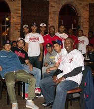 Boston Astros players, coaches, alumni and friends gathered on Sunday evening to watch the Red Sox beat the Cardinals in Game 4 of the World Series.  The private event drew more than 100 people – including most of the Astros' Triple Crown Sports US Baseball Championship team, and Astros alumni who have gone on to play professional baseball including Juan Carlos Portes, formerly of the Minnesota Twins, Eddy Morabel, who recently signed as a free agent with the Texas Rangers, and Vladimir Camacho, recently drafted into the Frontier League. Also in attendance: Robert Lewis, Jr., founder and president of The BASE and the Boston Astros; WCVB's CityLine Host Karen Holmes Ward and her husband, Forrest Ward, Mark Culliton, Executive Director of College Bound Dorchester, Chris Byner of Boston Centers for Youth and Families, Denise Korn of Korn Design and Youth Design, and Scott Tully, Novaya Real Estate Ventures. Boston Astros team is comprised of elite players, primarily from Dorchester, Roxbury and Mattapan. Each player 'earns their spot,' and there is no fee to participate on the team, contrary to most elite suburban teams. The Astros earned several impressive championships this season, and more importantly, are celebrating success off the field with 16 of 17 graduating seniors going on to college.