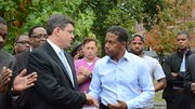 City Councilor John Connolly greets businessman Clayton Turnbull at a recent campaign event.