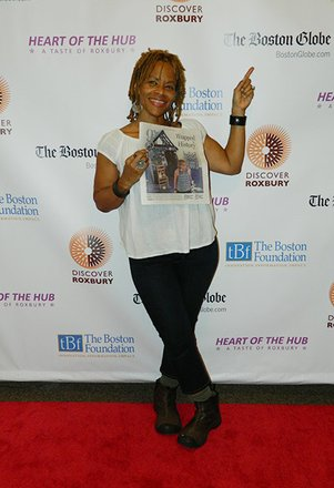 Artist Ife Franklin showing off article in newspaper!