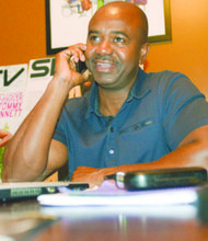 SWERV Magazine Publisher Jamil A. Fletcher at work on SWERV inside of his home in Upper Marlboro, Md.