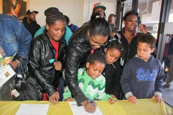 Felicia Smith of Landover, Md., made it a point to be at the front of the line to ensure that she could enroll Imani Williams, 10, Sherlena Percy, 7, and Courtney Smith in activities at the Palmer Park Boys and Girls Club during the grand opening on Saturday, Oct. 26.
