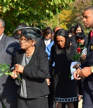 Sheila Stewart's mother, Dorothy Stewart, is led into the University Park Baptist Church in Charlotte, N.C., on Oct. 30 for her daughter's funeral service. Stewart, a longtime radio personality in D.C., was killed Oct. 24 in an automobile accident in Atlanta. (Paul Williams/Paul-3 Photography)