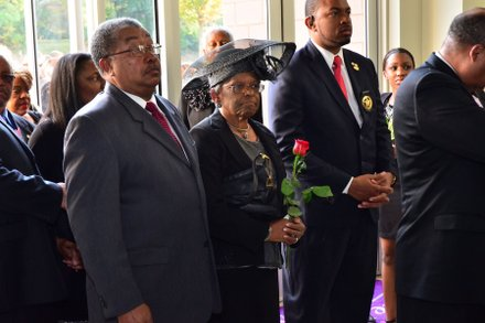Sheila Stewart's mother, Dorothy Stewart, is led into the University Park Baptist Church in Charlotte, N.C., for her daughter's funeral service on Oct. 30. Stewart, a longtime radio personality in D.C., was killed Oct. 24 in an automobile accident in Atlanta. (Paul Williams/Paul-3 Photography)